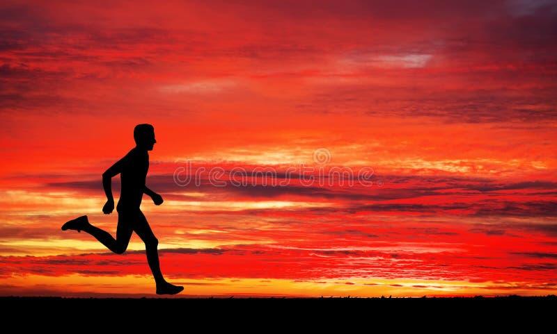 Running man on apocalyptic sunset sky. Background stock photo