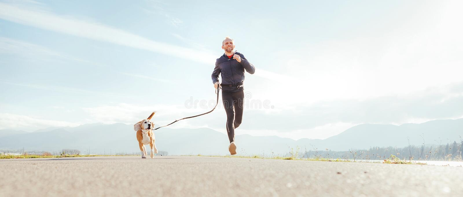 Running man with his dog . Active healthy lifestyle concept image stock photos