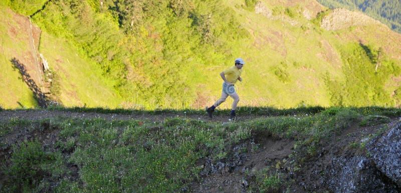 Running Man on Mountain Trail. Running Man on Saddle Mountain Trail, Oregon royalty free stock photo