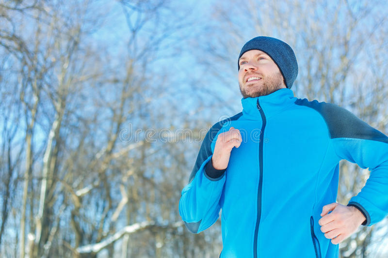 Running man outdoors in winter stock photography