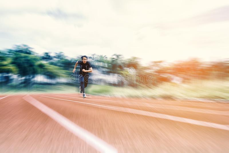Running Man running on the track with radial blur, Sport and Activity concept.  royalty free stock photography