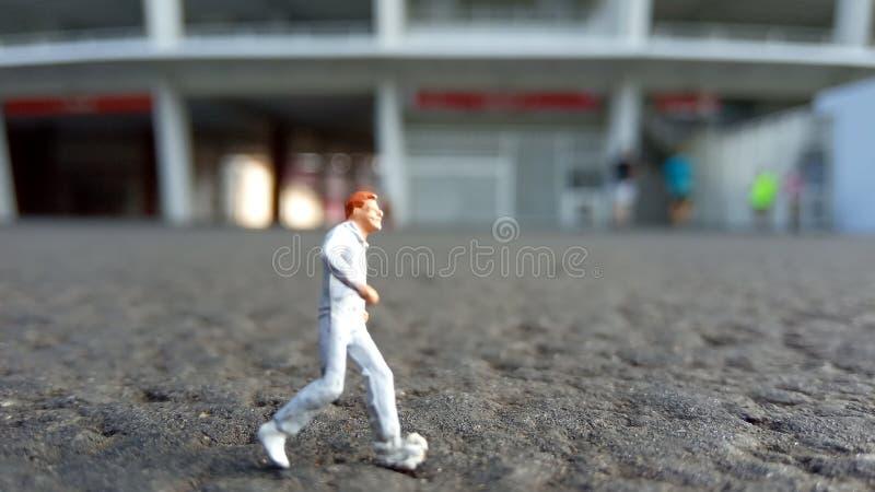 Running Mini Figure man in the morning, at Gelora Bung Karno Stadium stock image
