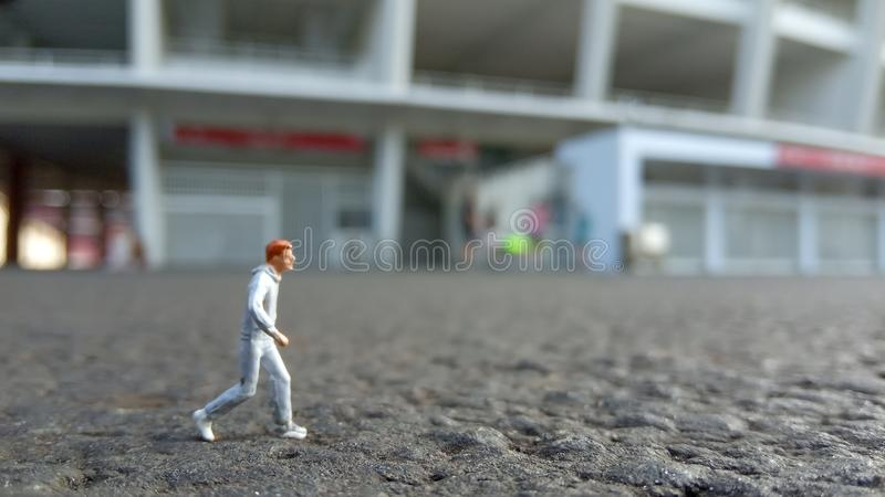 Running Mini Figure man in the morning, at Gelora Bung Karno Stadium stock photos