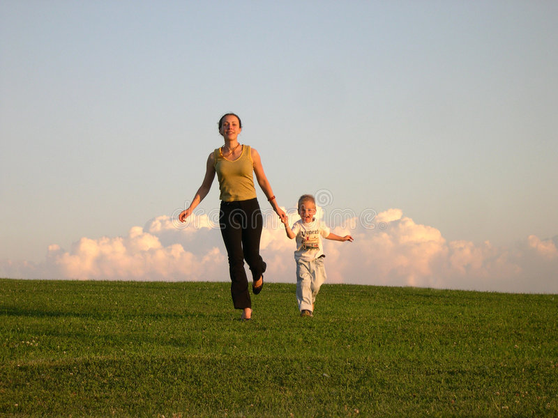 Running mother with son royalty free stock photography