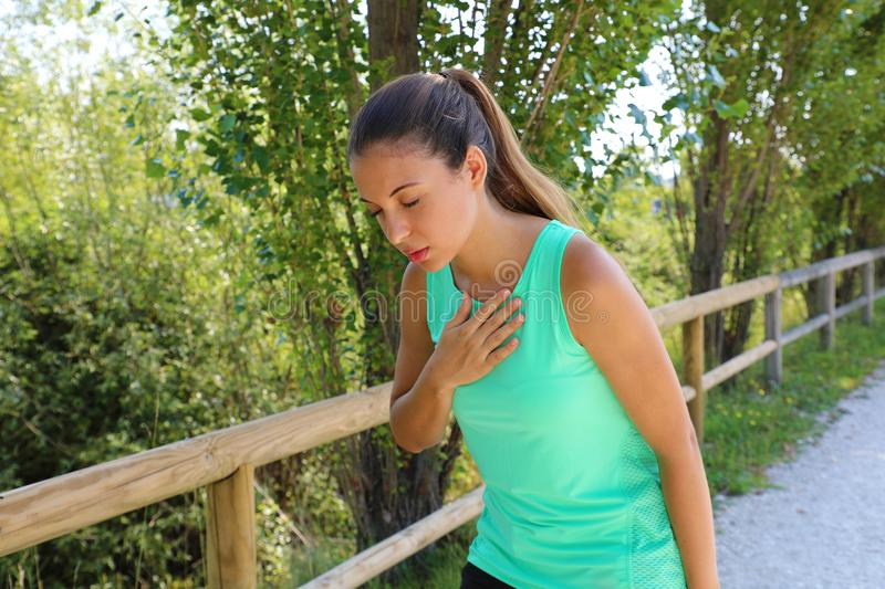 Running nausea. Nauseous and sick ill runner vomiting. Running woman feeling bad about to throw up. Girl having nausea from. Dehydration or chest pain stock photography