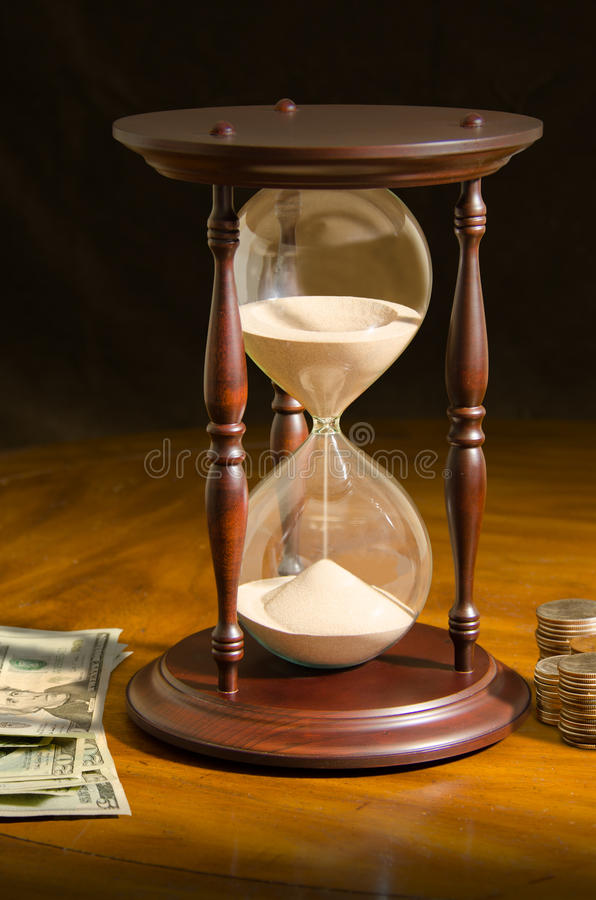 Running out of time is money hour glass investment royalty free stock photos