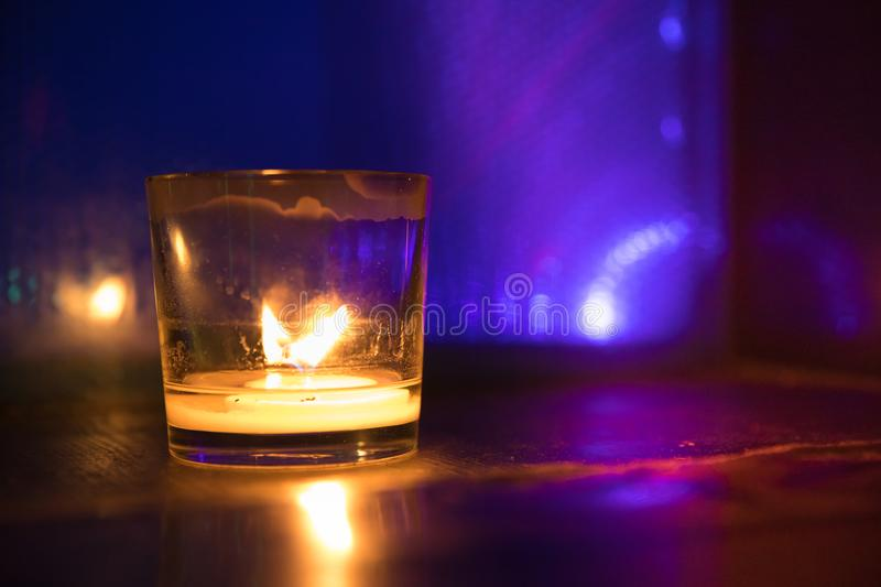 Burning candle light in a glass. Burning candle light. Running out of wick candle will soon fade. Time running out stock photography