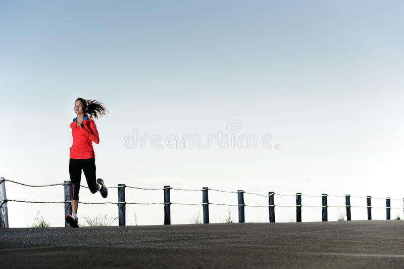 Running outdoors woman royalty free stock photo