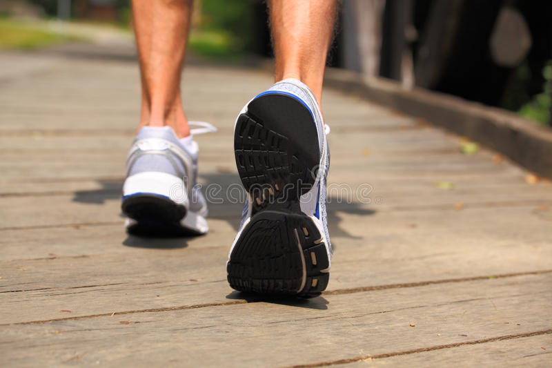 Download Running In Park - Close-up On Sport Shoes And Legs Stock Photo - Image: 26949940