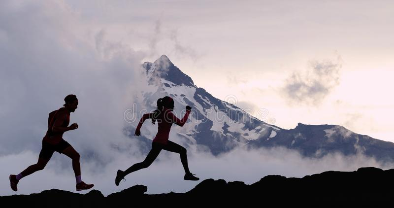 Running people athletes silhouette trail running in mountain summit background stock photo