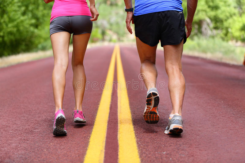 Running people - runners jogging shoes and legs stock photos