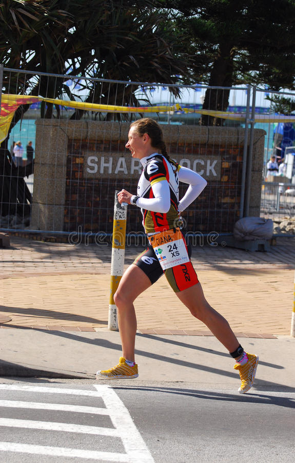 Running professional triathlete stock photos