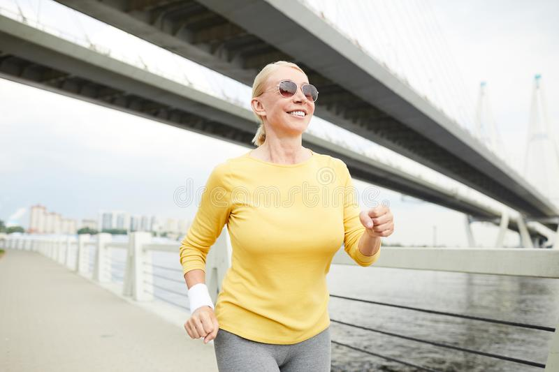 Running by riverside stock photography