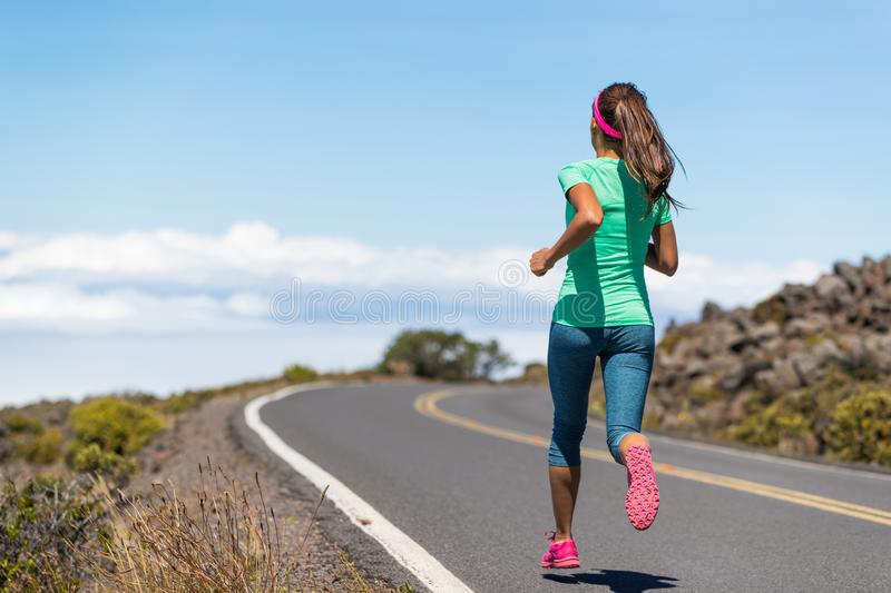 Running runner woman on run goal challenge. Fitness girl training cardio on road to success. Active healthy lifestyle stock images
