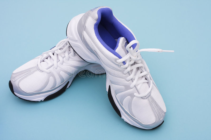 Running Shoes. On blue background with copy space stock photo