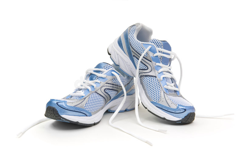 Running shoes. Pair of running shoes on a white background with untied laces stock images