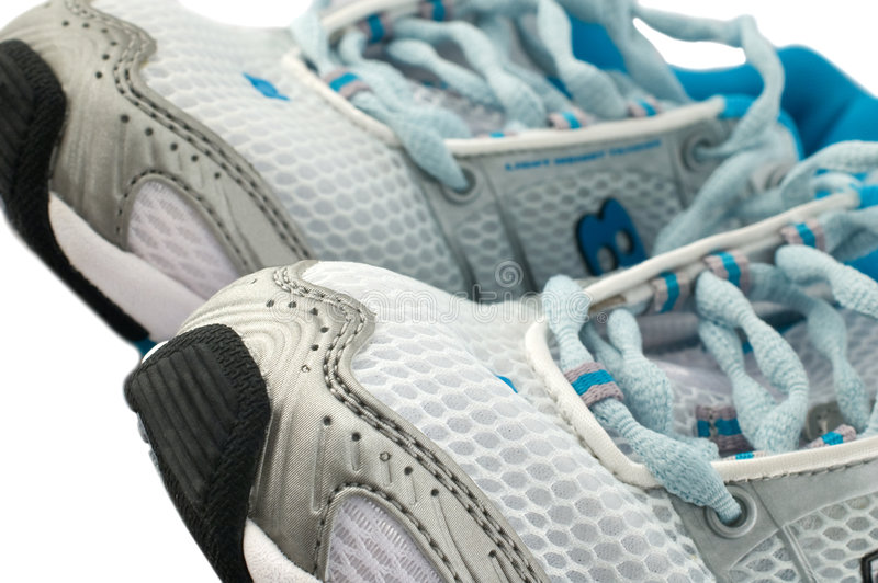 Running shoes. Close up of a pair of running shoes isolated on white. Shallow depth of field royalty free stock photo