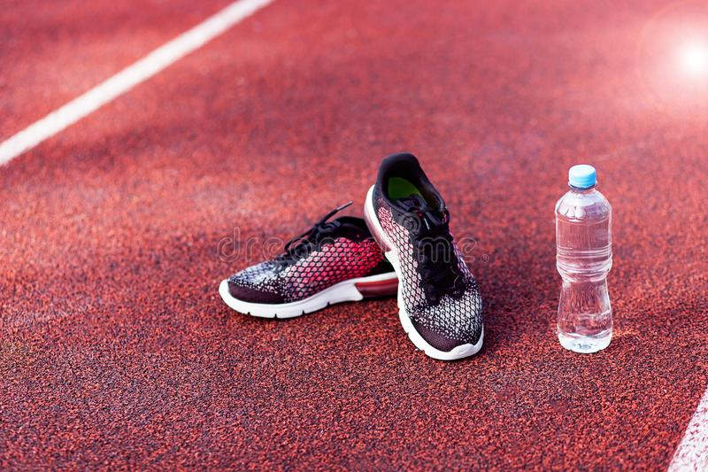 Running shoes and bottle of water royalty free stock image