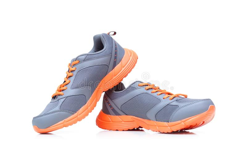 Running shoes. With grey and orange colors royalty free stock photo