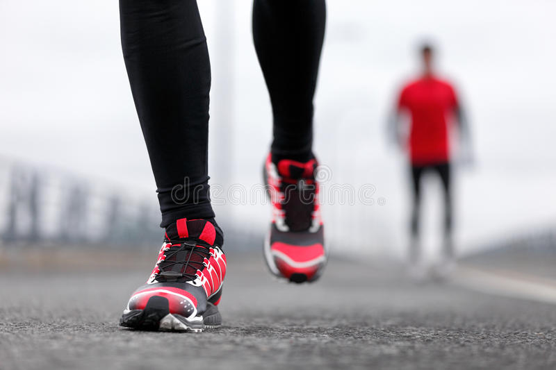 Running shoes of men athletes runners in winter stock photos