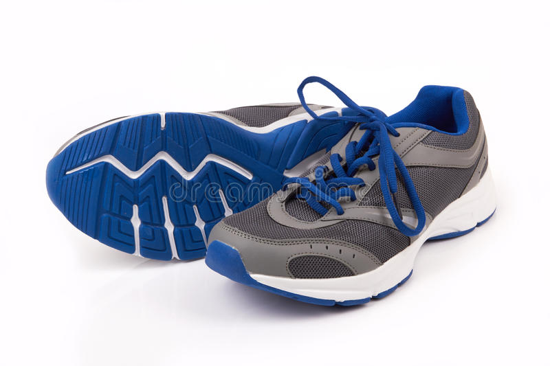 Running shoes. Pair of running shoes over a white background stock photos