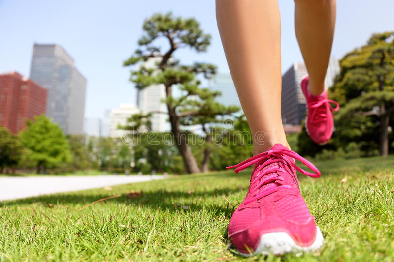 Running shoes - woman jogging in Tokyo Park, Japan stock images