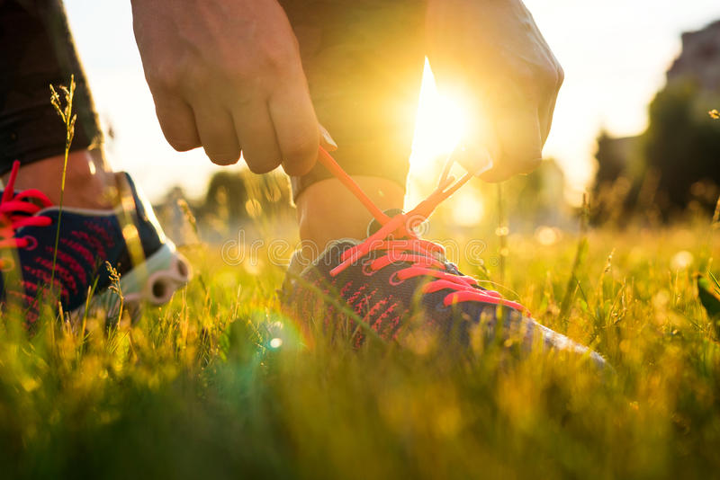 Running shoes - woman tying shoe laces stock image