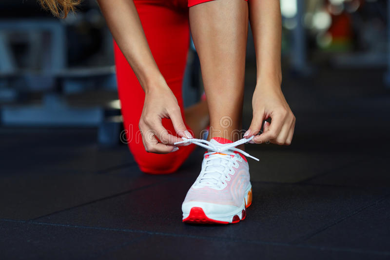 Running shoes - woman tying shoe laces royalty free stock photo