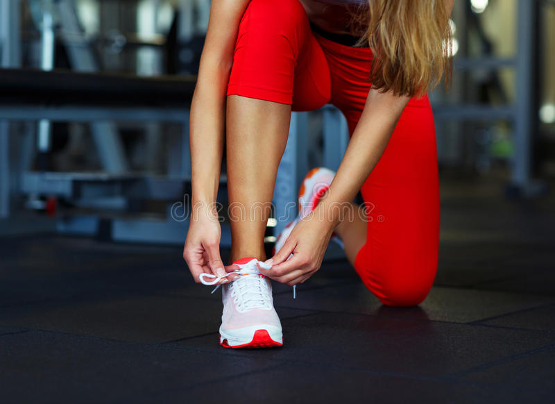 Running shoes - woman tying shoe laces royalty free stock images