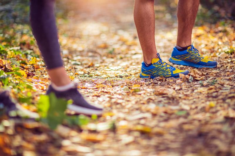 Running sport fitness man. Close up of male legs and shoes. Man athlete fitness runner running shoes. Trail running concept royalty free stock images
