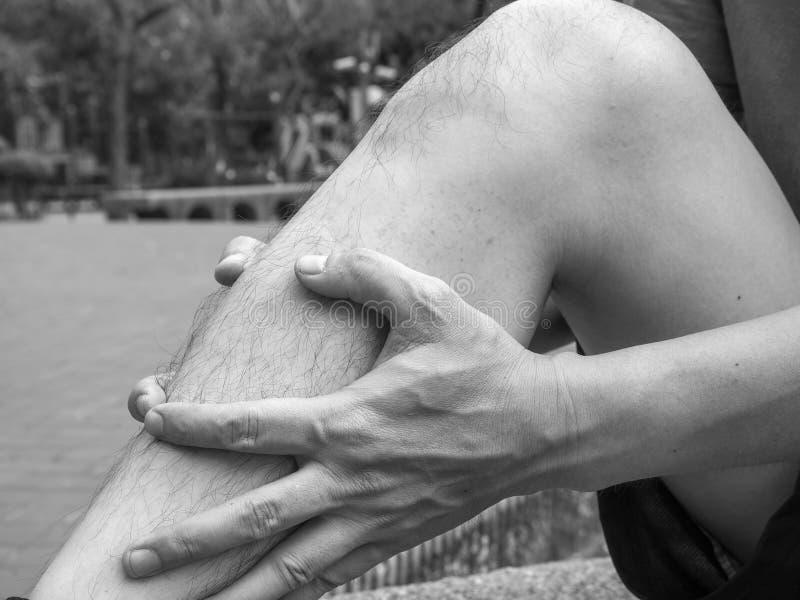 Running sport injury. male athlete jogger wearing man runner massaging calf muscle before workout.  royalty free stock photos