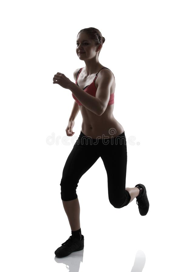 Running sport woman, silhouette studio shot over white. Background royalty free stock images
