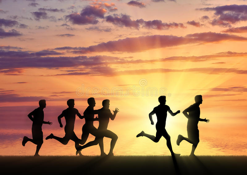 Running sports. Competition athletes runners. On the sunset background stock photos
