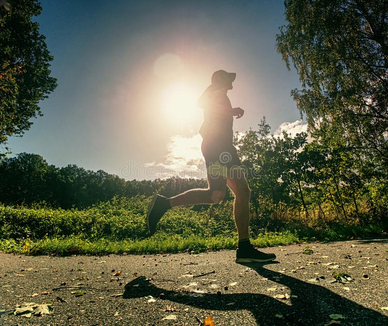 Running sportsman freeze within quick moment in front of camera royalty free stock image