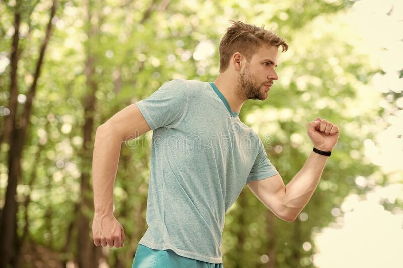 Running. sportsman full of energy. man making sport outdoor. sportswear fashion. health and fitness. run to success. Endurance and stamina. aerobic and stock photography
