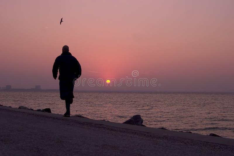 Running at sunrise stock image