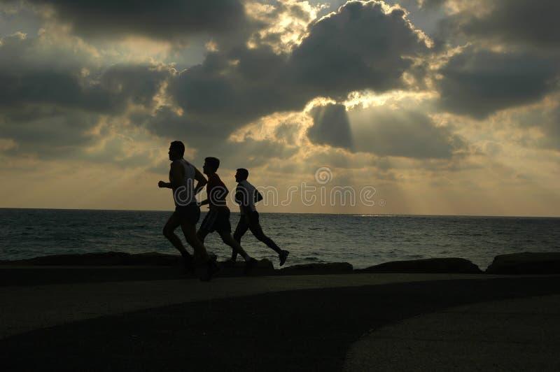 Running at sunset stock image