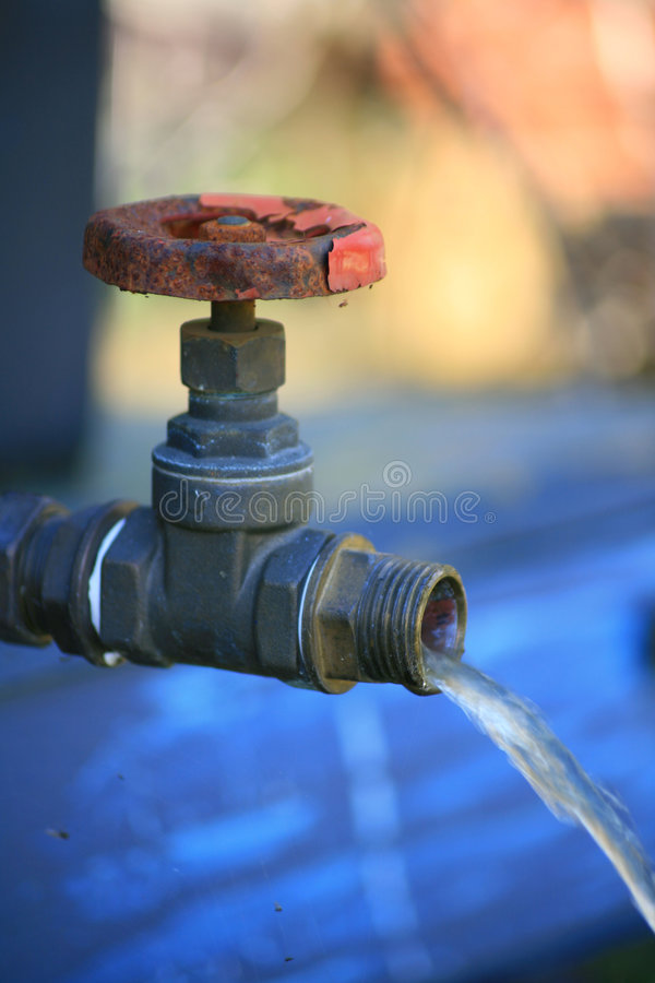 Running tap stock image