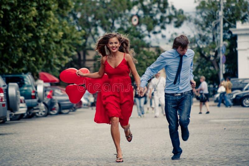 Running teenage couple stock image