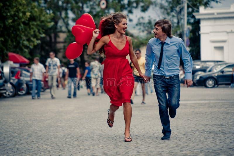 Running teenage couple stock photos