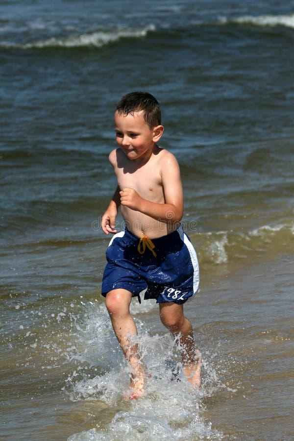 Free Running Through Waves Royalty Free Stock Image - 6136846