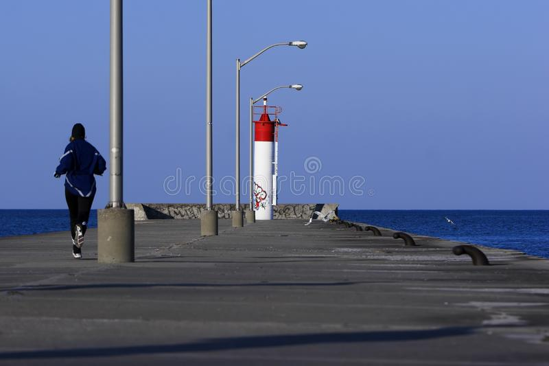 Download Running To The End Of A Pier Stock Photo - Image: 4882018