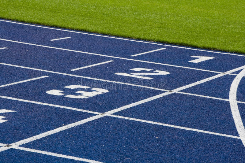Running track. A running track in blue and white royalty free stock photography