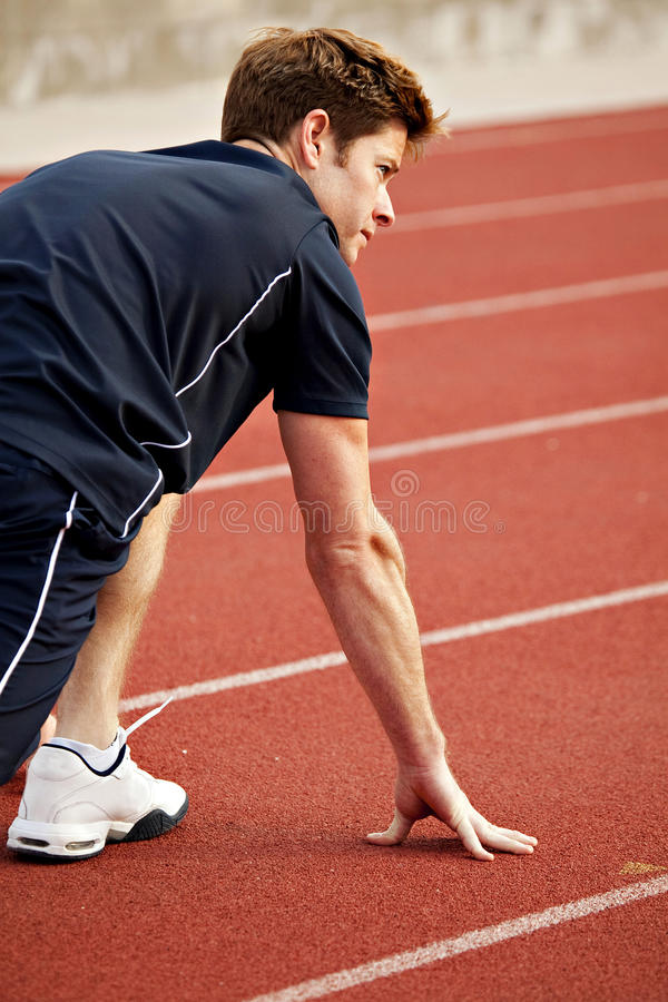 Running track. Man ready to start running a track royalty free stock photos
