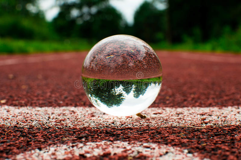 Running track with glass sphere royalty free stock image