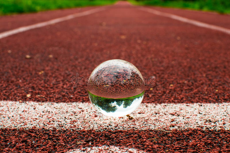 Running track with glass sphere royalty free stock photos
