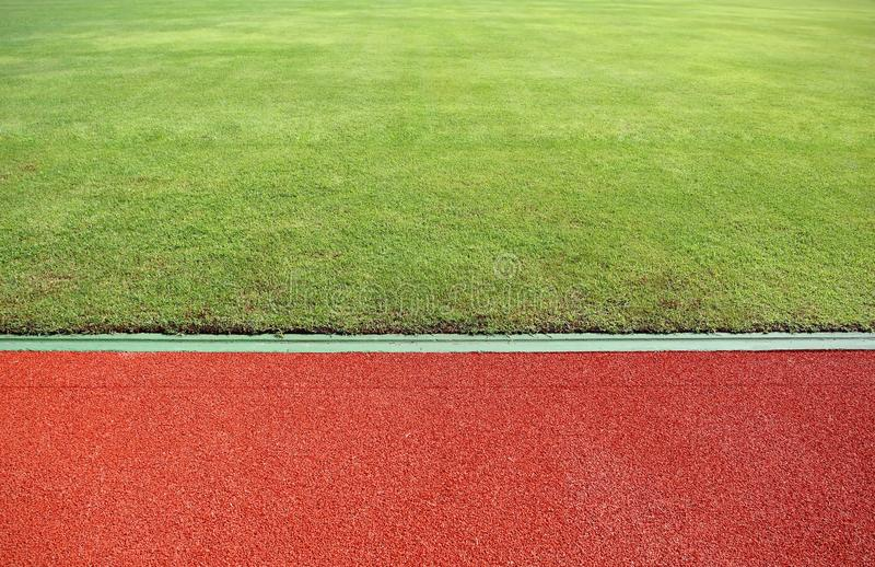 Running Track And Green Field royalty free stock photos