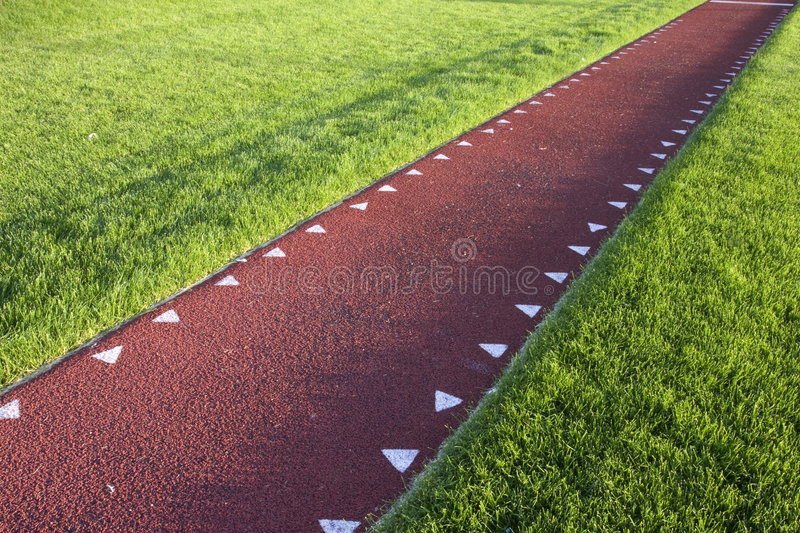 Running track for a long jump competition royalty free stock image