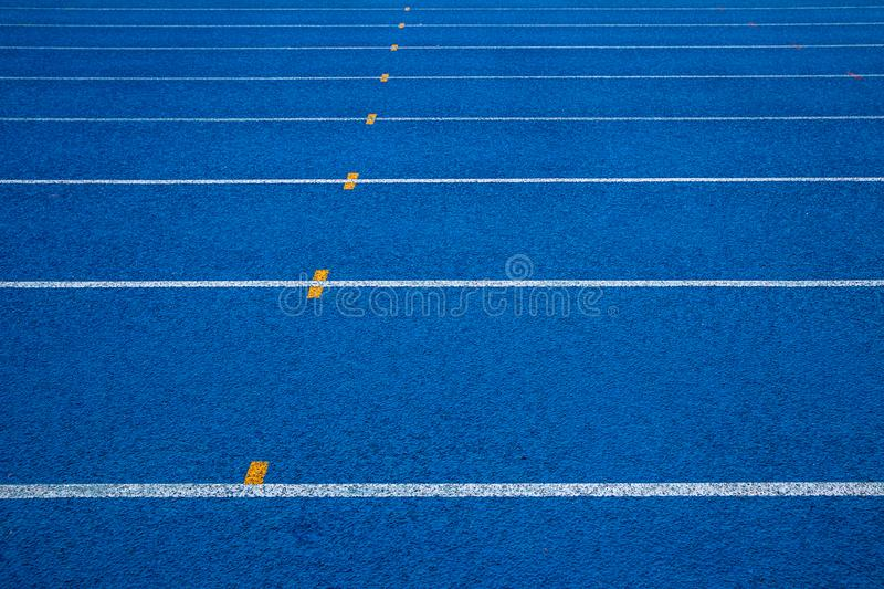 Running track with number. Blue running track in stadium. stock images