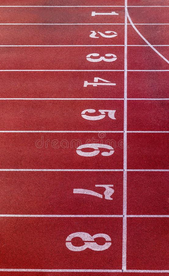 Running track with number. Red running track in stadium. rubber running tracks in outdoor stadium. stock photos